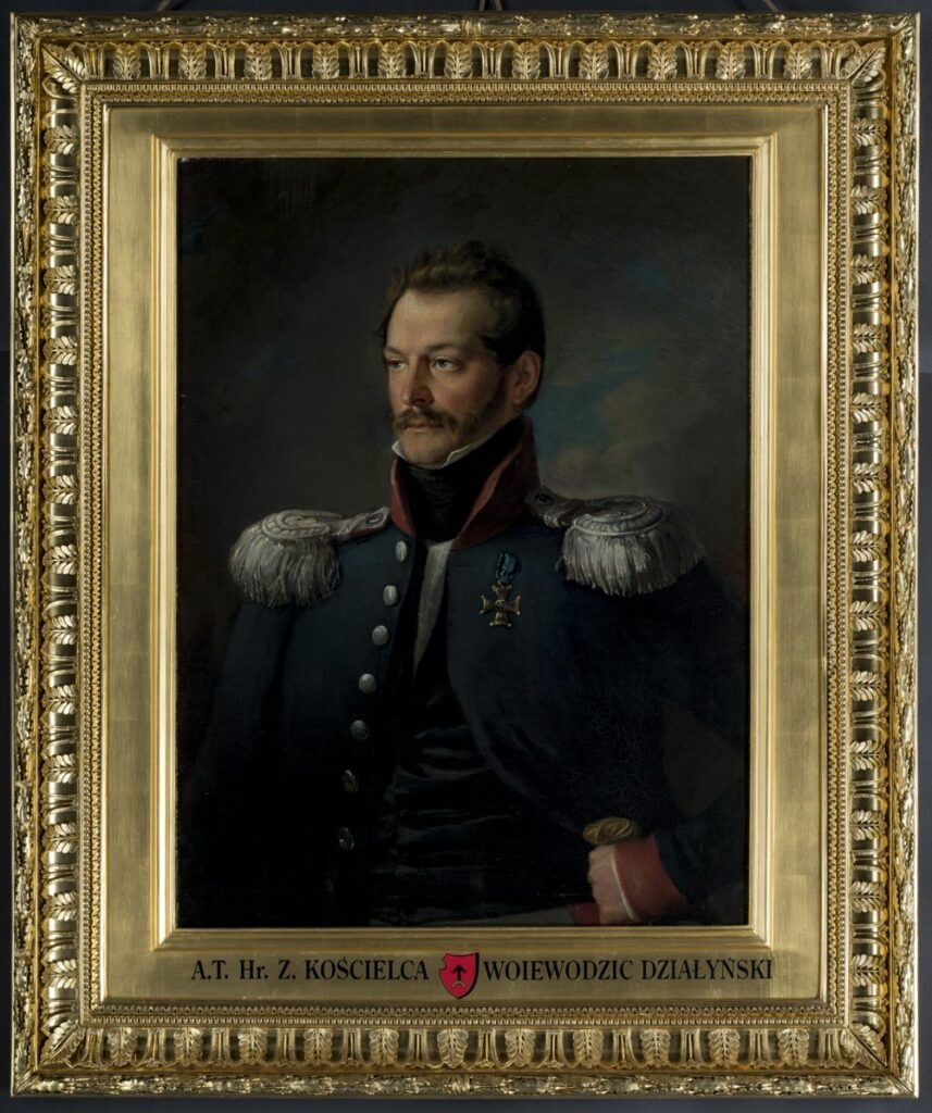 Półpostaciowy portret mężczyzny w średnim wieku zwróconego twarzą i sylwetką w trzech czwartych w lewo. Mężczyzna ubrany w rozpiętą, błękitną kurtkę wojskową z wysoką, czerwoną stójką, czerwonym mankietem pod którym widoczny mankiet białej koszuli oraz szeregiem srebrnych guzów na prawej pole. Na ramionach srebrne epolety z trzema złotymi gwiazdkami, z taśmą przypiętą przy obojczykach ciemnosrebrnymi guzami. Na lewej piersi Order Virtuti Militari. W rozpięciu kurtki widoczna czarna, aksamitna kamizelka, pod którą koszula z żabotem i wysokim kołnierzykiem ze stójką przewiązanym czarną chustką. Przy dolnej krawędzi pola obrazowego widoczny fragment białego pasa. Twarz rumiana, z prostym nosem, bokobrodami i wąsem w kolorze blond, włosy kędzierzawe, także w kolorze blond, na skroniach zaczesane do przodu, nad czołem w tył. Prawa ręka opuszczona wzdłuż ciała, lewa wsparta na rękojeści szabli ze złotą głowicą. W tle niebo zasnute ciemnoszarymi chmurami, z prześwitem jaśniejszych chmur i błękitu na prawo od głowy postaci.